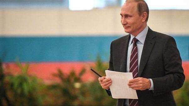 Putin's proposed U.N. Ukraine peacekeepers must have full access - Merkel