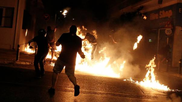 Petrol bombs and tear gas in Athens rally to mark rapper killing