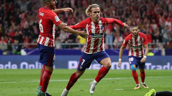 Atletico show classic grit in triumphant start to new era
