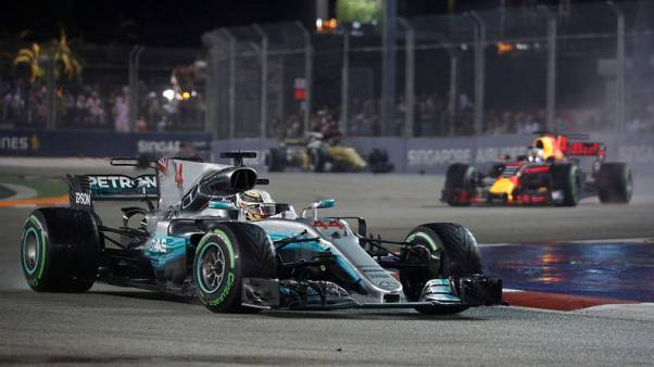 Vettel out of Singapore GP as Hamilton leads