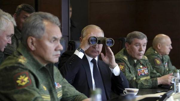 Putin to watch parachute drop, part of war games that have rattled West