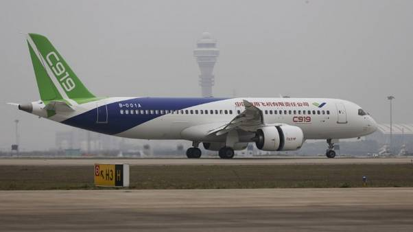 China's COMAC says signs 130 orders for C919 passenger jet
