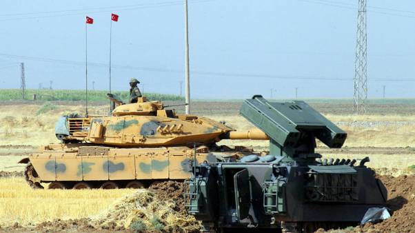 Turkish tanks trained on northern Iraq in show of force ahead of vote