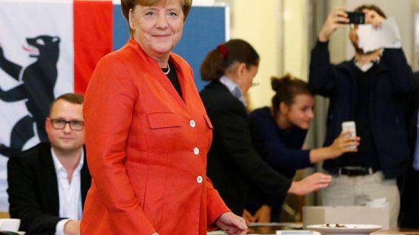 Merkel heading for fourth term in splintered German vote - poll