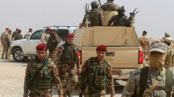Les forces irakiennes attaquent un fief de l'EI près de la Syrie