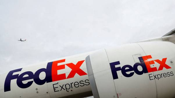 Cyber attack, hurricane weigh on FedEx quarterly profit