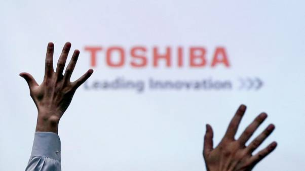Toshiba says seals $18 billion deal to sell chip unit to Bain Capital group