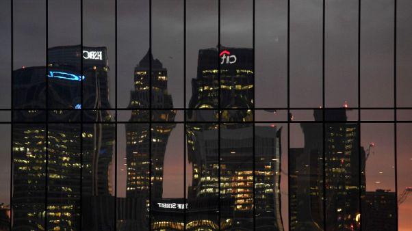 Britain's finance watchdog cuts firms some slack on EU reforms