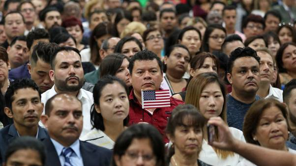 Trump makes his debut at ceremonies for new U.S. citizens