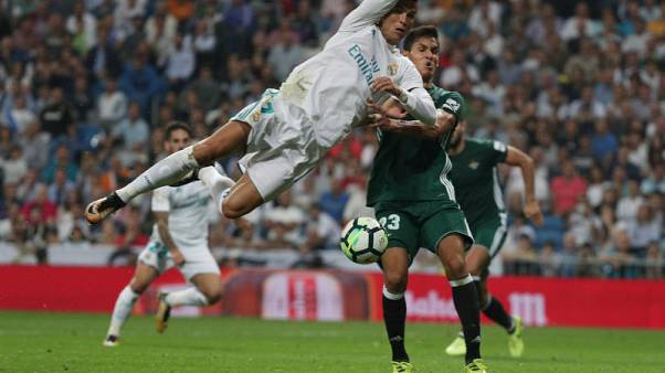 Real Madrid stunned by last-gasp Sanabria header for Betis