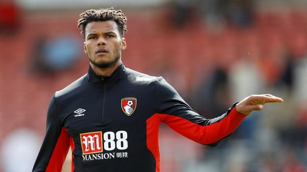 Bournemouth defender Mings ruled out for a month with injury