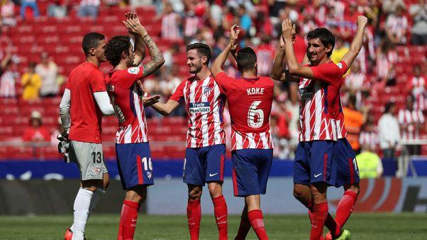 Atletico second as Carrasco, Griezmann strikes down Sevilla
