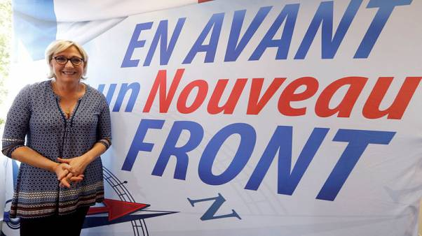 Brooking no dissent, Marine Le Pen takes grip on French far-right
