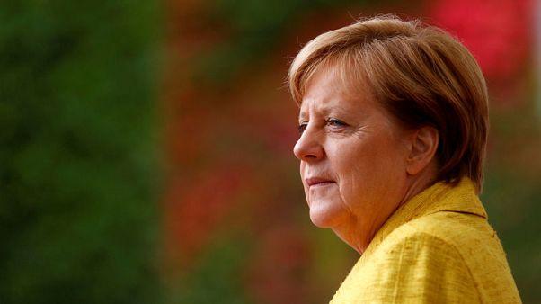 Merkel welcomes 'a lot of material' from Macron for EU reform debate