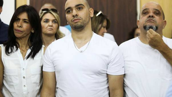 Israel cuts jail term of soldier who killed prone Palestinian assailant