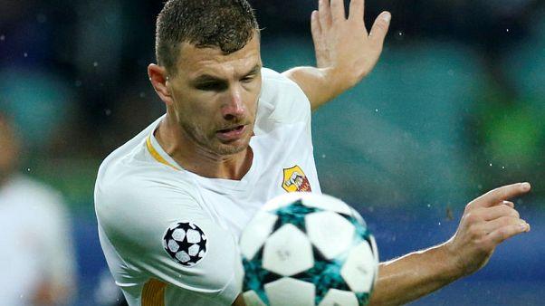 Roma grind out 2-1 win at battling Qarabag