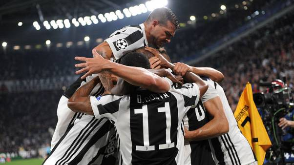 Higuain on target as Juventus beat Olympiakos 2-0