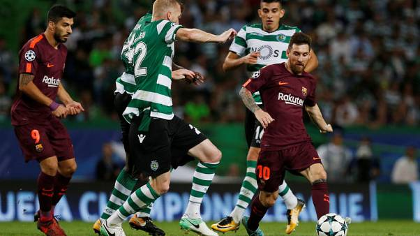 Barcelona labour to victory at Sporting