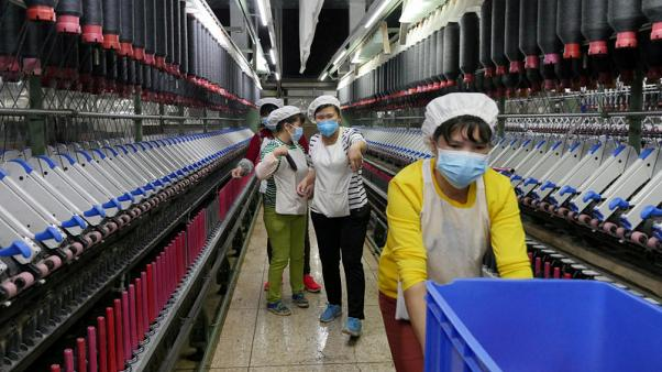 China September factory activity seen growing at slightly slower pace