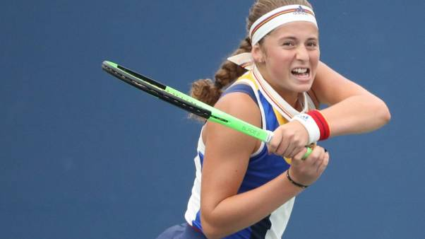 Ostapenko finds busy schedule to her liking after Wuhan win