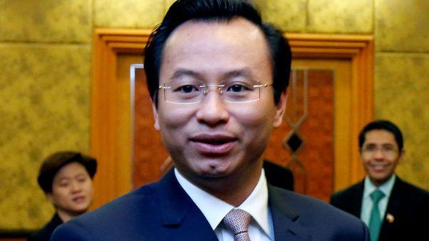Vietnam court sentences to death PetroVietnam ex-chairman in mass trial
