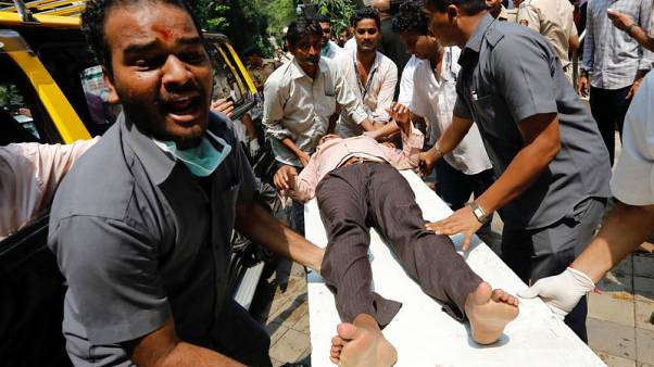 Indian railway rush hour stampede kills at least 15 - official