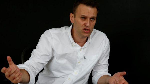 Putin critic Navalny says police detain him ahead of pre-election rally
