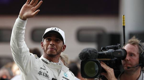 Hamilton storms to Malaysia pole, Vettel last on grid