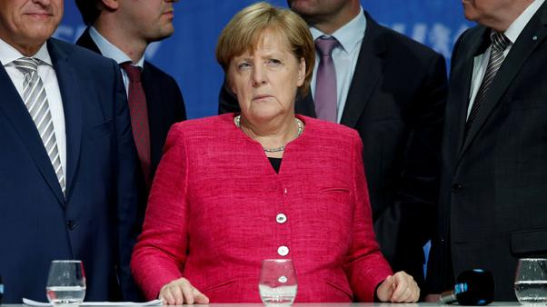 Merkel allies fret over former East Germany's rightward shift
