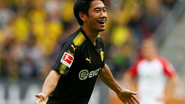 Kagawa's record goal gives Dortmund win at Augsburg