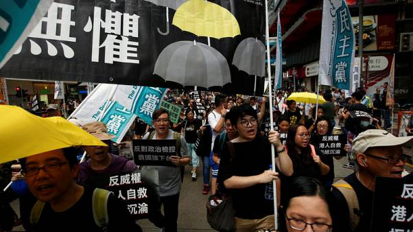 Tens of thousands march to defend Hong Kong's rule of law against China