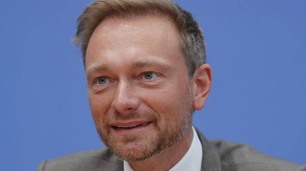 In change of tone, leader of German FDP calls Macron a 'godsend'