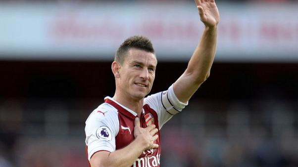 Arsenal's Koscielny, Ozil and Welbeck out of World Cup games