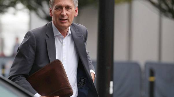 'Our economy is not broken,' says Hammond, defending capitalism