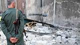 Deadly twin suicide attack hits Damascus police station