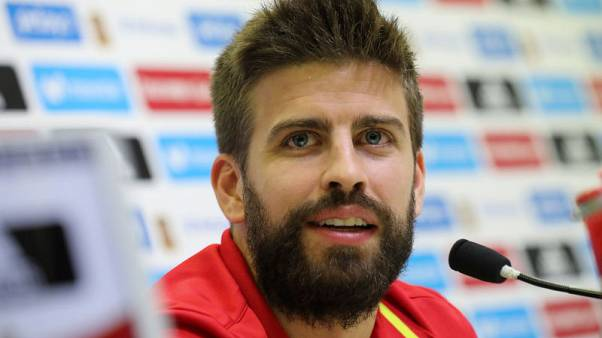 Catalan Pique jeered by fans at Spain training session