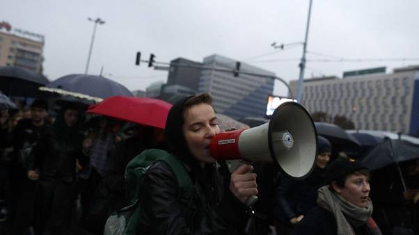 Poles dressed in black march in defence of women's rights