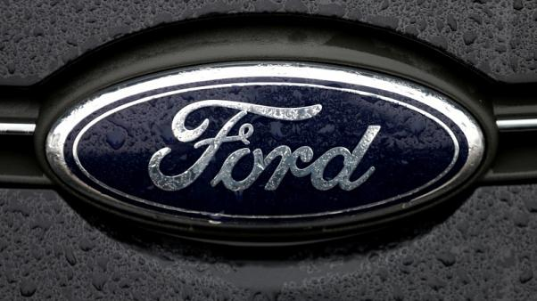 Ford to cut costs $14 billion, invest in trucks, electric cars - CEO