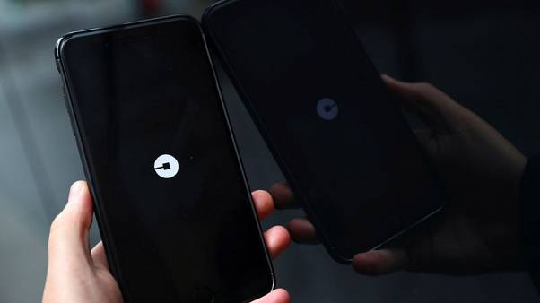 Uber says board approves governance changes, SoftBank investment