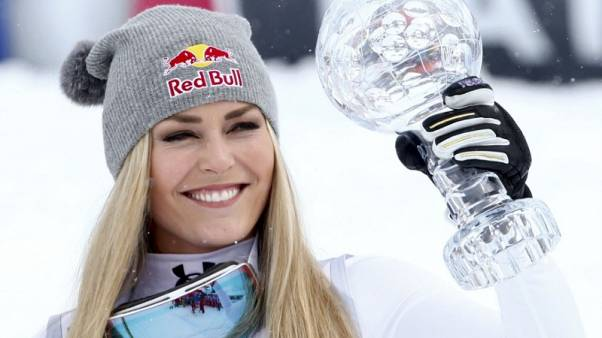 Alpine skiing-Vonn takes first step towards racing men