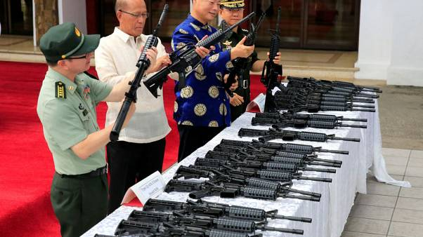 China gives guns to Philippines to show it's a friend, not a foe