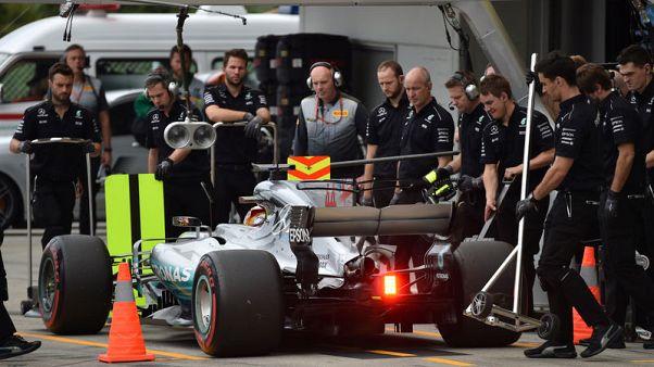 Motor racing-Hamilton on the hunt despite F1 title lead