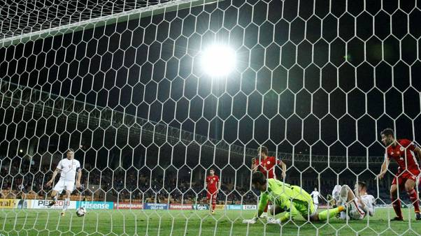 Lewandowski hat-trick puts Poland on brink of World Cup