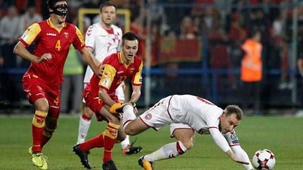 Denmark edge Montenegro to keep alive World Cup hopes