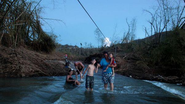 Destroyed bridge imperils Puerto Rican village cut off by hurricane