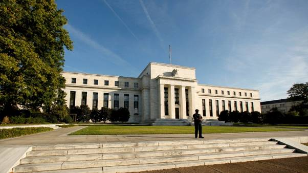 Downplaying job losses, Fed officials eye December rate hike