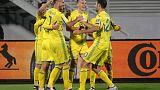 Ukraine revive hopes with rain-soaked win over Kosovo
