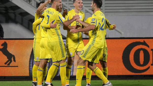 Ukraine revive hopes with rain-soaked win over Kosovo