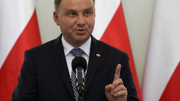 Polish ruling party and president say closer to strike deal over court reform