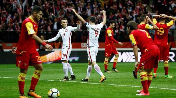 Poland reach World Cup with 4-2 win over Montenegro